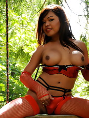 Transsexual sweetheart Carmen Moore posing in the woods