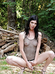 Sexy tgirl Mandy Mitchell getting nasty in the woods