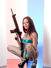 Smoking hot tgirl posing with a gun