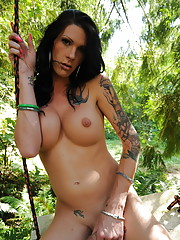 Beautiful Morgan Bailey swinging naked in the forest