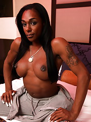 Chocolate sweetheart Natalia Coxxx stripping on bed