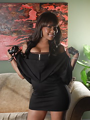Busty chocolate sweetheart stripping