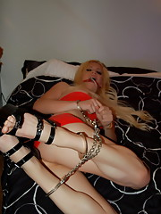 Gagged and cuffed transsexual Jesse struggling in bed
