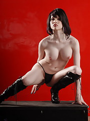 Beautiful Sarina Valentina stripping in sexy boots