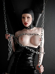 Naughty Sarina Valentina playing with chains in hot latex dress