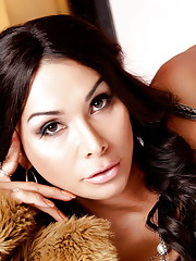 Sexy transsexual sweetheart Vaniity posing on the bed