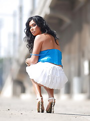 Irresistible transsexual cutie Vaniity posing on a street