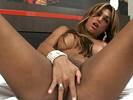 Alluring tgirl Mariana playing with herself in the bed