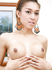 Slim ladyboy with big round breats!