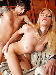 Blonde tranny strips and plays with a guy