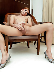 Reheaded Asian tranny shoots her warm cum