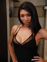 Asian ladyboy strips nude for the camera