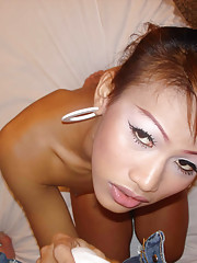 Cute Asian T-girl shows off tiny tits