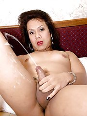 Asian tranny uses toy on tight ass