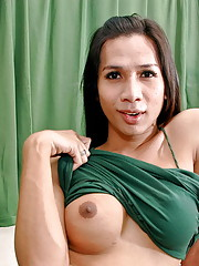 Long haired ladyboy babe shows boobs