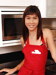 Erotic shemale poses in the kitchen