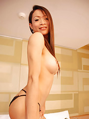 Long haired ladyboy strips for the camera