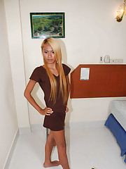 Long haired blonde ladyboy in lingerie