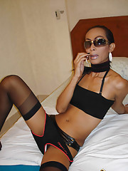 Exotic Asian ladyboy in thigh high stockings