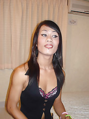 Sexy Asian ladyboy shows off tattoos