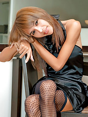 Leggy ladyboy lathers in oil her protruding shaft