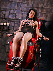 Chained Jaquelin posing her juicy fat cock