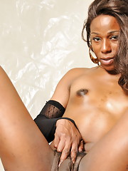 Gorgeous chocolate hottie Tina posing in fishnets