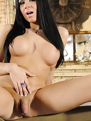 Glamorous Ashley George strips and poses