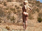 Absolutely gorgeous transsexual Kimber James posing in the desert