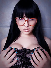 Glamorous Bailey Jay posing in a sexy dress