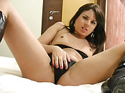 Sexy brunette tranny fondling her shecock