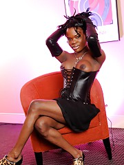 Ebony tgirl Elexa posing in hot leather corset