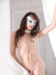 Dirty TS Jonelle Brooks posing with a mask