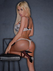 Busty transsexual Kimber strips & poses