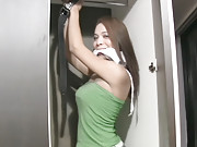 Brunette asian shemale showing her big cock