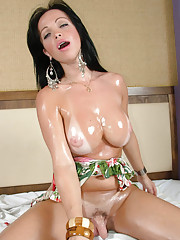 Thick shemale meat gets a hard tugjob by a big tittied brunette shemale