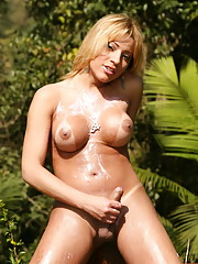 Stunning blonde tranny plays strips outside