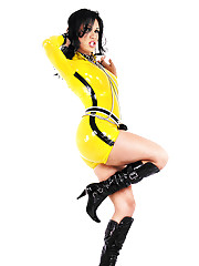 Skimpy yellow latex clad shemale babe