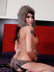 Naughty tgirl Eva Lin stripping on the bed