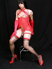 TS Sasha posing in hot red dress & black stockings