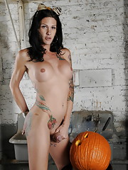 Horny TS Morgan Bailey playing with a pumpkin