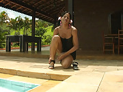 Tanned tranny plays topless in pool