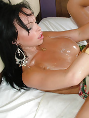 Slutty shemale shows off her oiled tits and phat ass