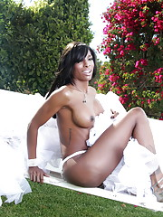 Chocolate TS Natassia posing outdoors