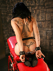 Chained tgirl Stephany Tricks in sexy stockings