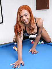Ebony goddess Candi Love posing on the pool table