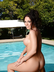 Beautiful Ashley George stripping by the pool