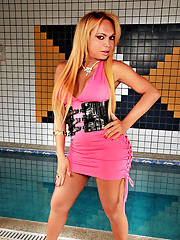 Mega cock blonde tranny poses by the pool