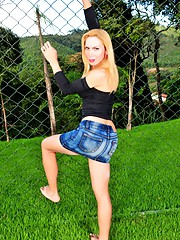 Stunning transsexual Veronica stripping outdoors