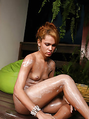 Hot blonde T-girl rubs lotion on her phat ass